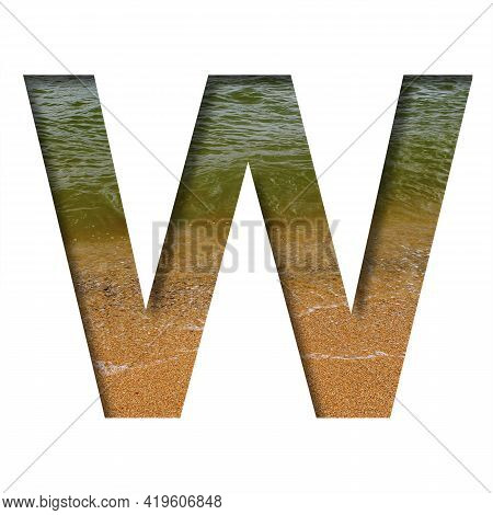 Sea Shore Font. The Letter W Cut Out Of Paper On A Background Of The Beach Of Seashore With Coarse S