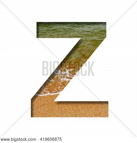 Sea Shore Font. The Letter Z Cut Out Of Paper On A Background Of The Beach Of Seashore With Coarse S