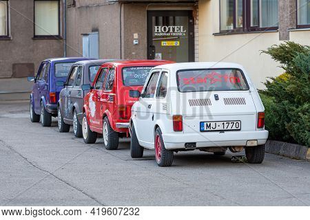Madona, Latvia - May 01, 2021: Several Colorful Oldtimer Rental Cars Fiat 126 Parked In The Yard