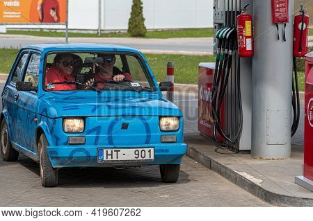 Gulbene, Latvia - May 02, 2021: A Colorful Vintage Car Fiat 126 Refueling At The Gas Station