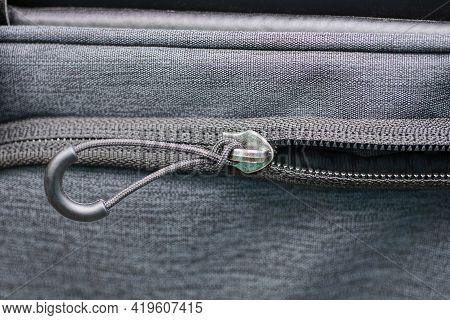 One Metal Zip With Drawstring On The Gray Fabric Of The Garment