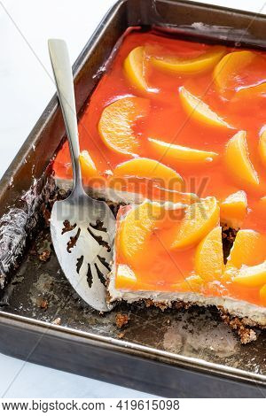 Close Up Of A Pan Of Peach And Pretzel Jelly Dessert Ready For Serving.