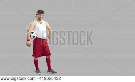Happy Chubby Soccer Player Holding Ball And Smiling Standing On Copy Space Background