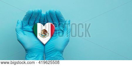 Doctors Hands Wearing Surgical Gloves Holding Mexico Flag Heart