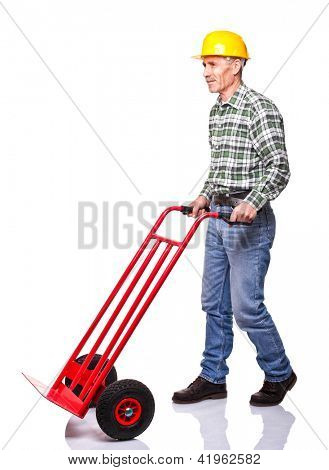 senior carpenter with handtruck on white