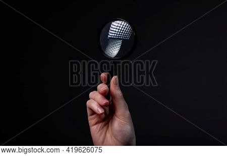 Magnifying Glass Or Loupe In Female Hand On Black Background. Concept Of Searching In Night, Darknes