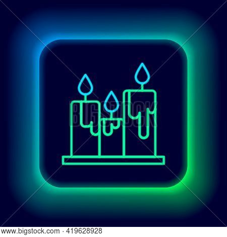 Glowing Neon Line Burning Candles Icon Isolated On Black Background. Cylindrical Candle Stick With B