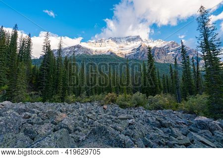Early Morning Light On A Top Of Mount Temple In Banff National Park. Trail To Consolation Lakes. Tal