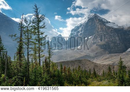 Lefroy Peak In Canadian Rockies Lit By Sunlight On A Partly Cloudy Day. Mt.lefroy Viewed From The Pl
