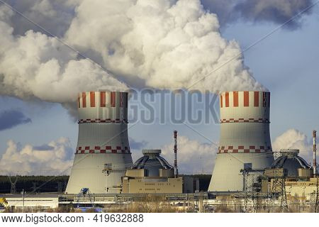 Cooling Towers Of Nuclear Power Plant Emissions Of Steam In The Air Atmosphere. Industrial Zone With