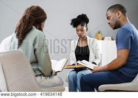 African Group Of People Reading Religious Book Together