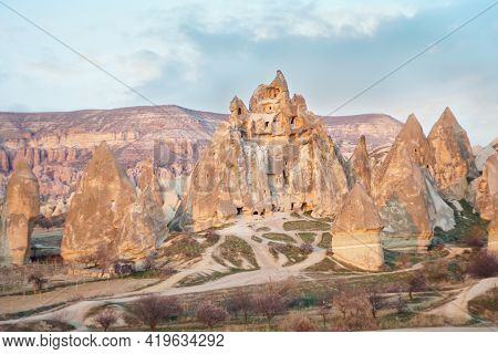 Amazing Cappadocia Landscape With And Caves In Mountains. Adventure In Turkey Tourist Destination Ca