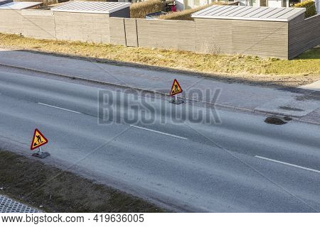 Landscape View Of Asphalt Road With Roadworks Sign. Sweden.