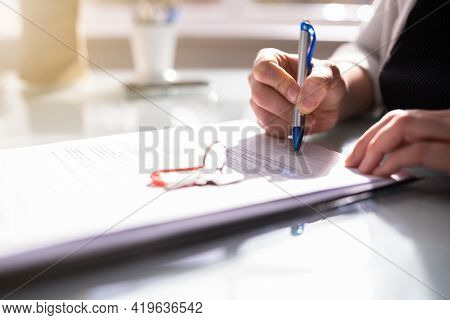 Signing House Rental Contract Document And Property Lending