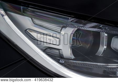 Headlight Lamp Of New Cars. Close Up Detail On One Of The Led Headlights Modern Black Car. Exterior