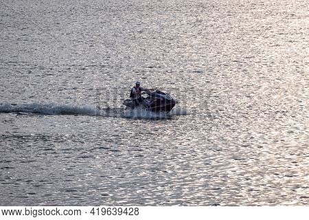 Guatapé, Antioquia, Colombia - April 3 2021: Latin Man Driving A Jetsky In The Waters Of The Dam In