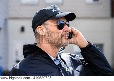 Security Guard Service. Defense And Protection. Man With Walkie Talkie