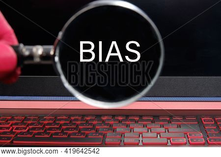 Magnifier With Text Bias On A Laptop Monitor.