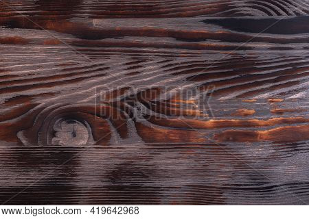 Old Grungy Burning Wood Surface Texture. Rustic Old Reclaimed Wood Background