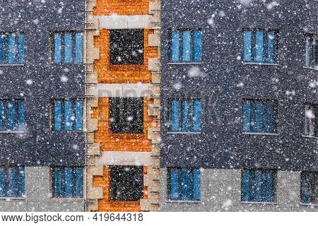 Unfinished Construction Of A Modern City Building Or Apartment In Winter In Cold And Snow On A Const