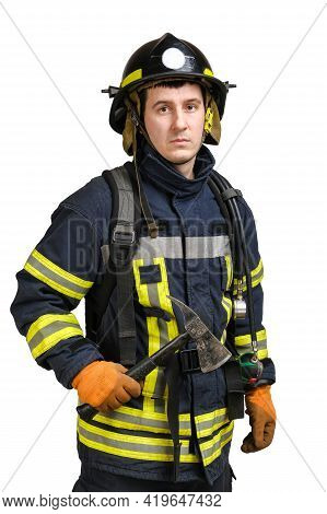 Young Brave Man In Uniform Of Firefighter Holds Axe In His Hand And Looking At Camera Isolated On Wh