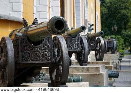 Moscow, Russia - 06 14 2016: Historic Cannons In Moscow Kremlin. Along The Facades Of The Arsenal Bu