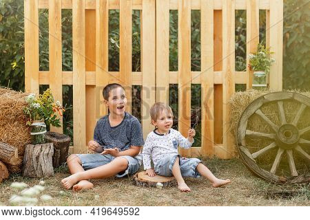 Childs Expression. Active Healthy Young Children. Two Happy Little Boys Playing In The Backyard. Pre