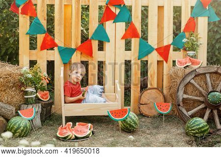 Funny Happy Child Eating Watermelon Outdoors. Cute Little Boy Eating Watermelon In The Summer Outdoo