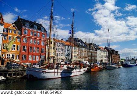 Copenhagen, Denmark - 2 May 2011: Scenic Summer View Of Nyhavn Pier With Old Buildings, Ships, Yacht