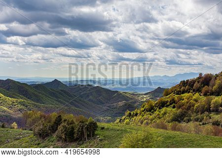 Mountain Peaks Landscape. Green Hills With Trees On Cloudy Day. Catalunya, Spain