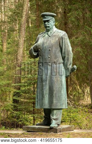 Druskininkai, Lithuania - May 1 2021: Stalin Bronze Sculpture In A Park, Russian Revolutionary, Poli