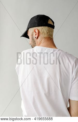 Rearview of a man in a white tee