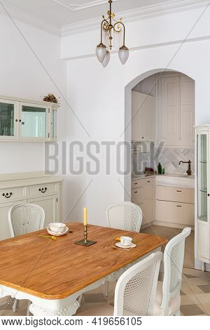 Wooden Dining Table Served For Two Persons In Classic Living Room Decorated In Retro Style With View