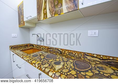 Interior Epoxy Resin And Wooden Tree Blocks Design Decor Showing Modern Kitchen With Cupboards And S