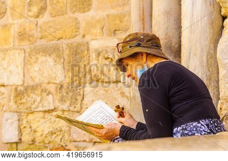 Jerusalem, Israel - April 30, 2021: View Of A Pilgrim, On Orthodox Good Friday, In The Courtyard Of
