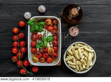 Trending Viral Feta Baked Pasta Recipe Made Of Cherry Tomatoes, Feta Cheese, Garlic, And Herbs In A