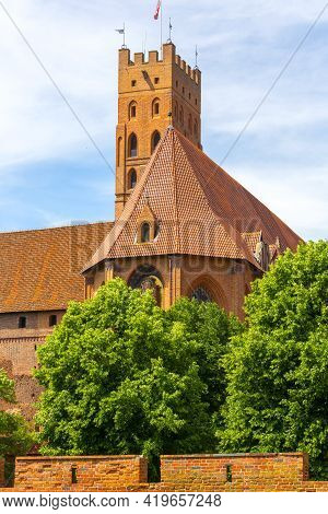 Malbork, Poland - June 25, 2020: 13th Century Malbork Castle, Medieval Teutonic Fortress On The Noga