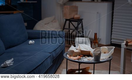 Close Up Of Table With Leftover On It In Empty Unorganized Messy Living Room