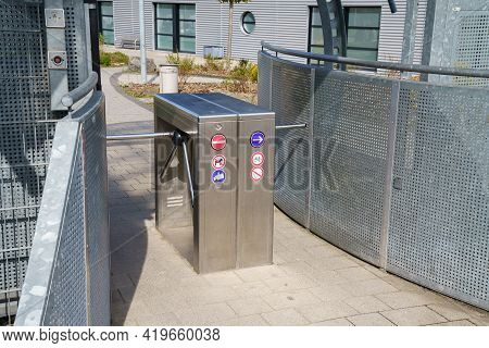 A Turnstile For Entering A Closed Area. It Has Various Prohibition And Direction Signs.
