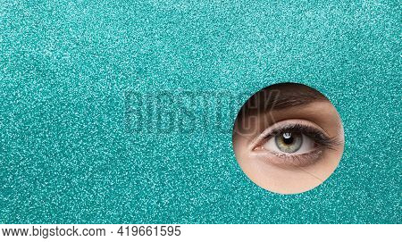 Eye Close Up. Beauty Woman Eye Macro Make Up. Eye Pupil Closeup Makeup Looking Out Hole Glitter Blue