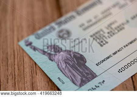 Rothenbrunnen, Switzerland - 25 April, 2021: Selective Focus Macro View Of An Economic Impact Paymen