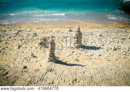Pile Of Stone On The Beach On The Lighthouse Phare Des Baleines On The Isle Of Ile De Ré In France O