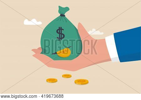 Tax Payment Or Losing Money Without Tax Planning Concept, Businessman Hand Holding Big Money Bag Of