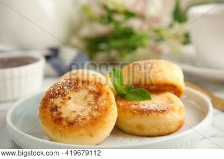 Delicious Cottage Cheese Pancakes With Mint And Icing Sugar On Table, Closeup