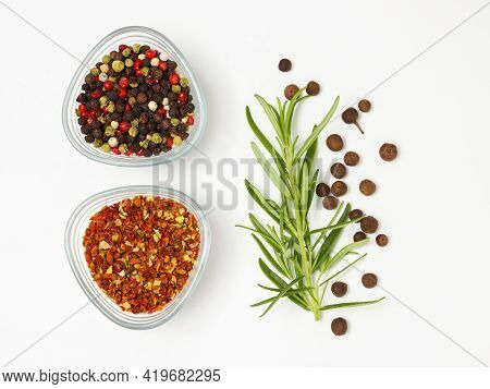 Spices In The Bowls With The Branch Of Rosemary And Peppers Scattered Around Top View, Colorful Pepp