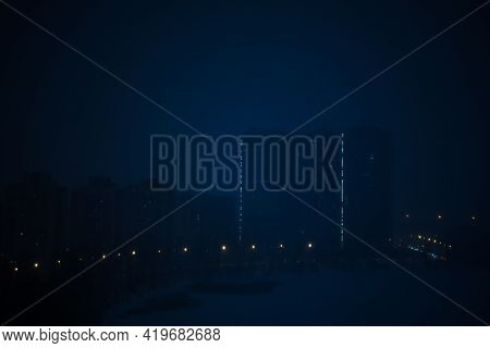 Night City On A Background Of Fog. Thick Blue Fog In A Dark, Scary Evening City. Magic And Mysteriou