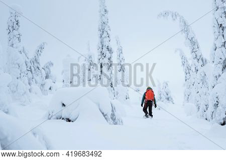 Mountaineer trekking in the snow at Lapland, Finland