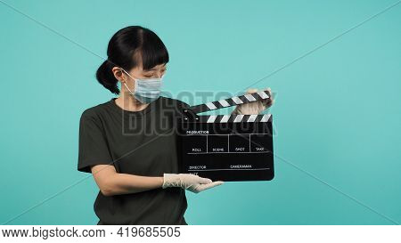 Black Clapper Board Or Movie Clapperboard Or Slate.asian Woman Wear Face Mask And Hand Wear Medical