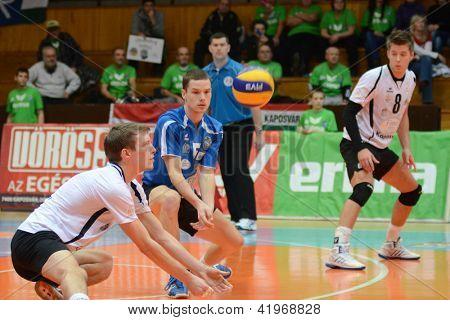 KAPOSVAR, HUNGARY - FEBRUARY 1: Bence Bozok (L) in action at a Middle European League volleyball game Kaposvar HUN (w) vs Innsbruck AUT (b), February 1, 2013 in Kaposvar, Hungary