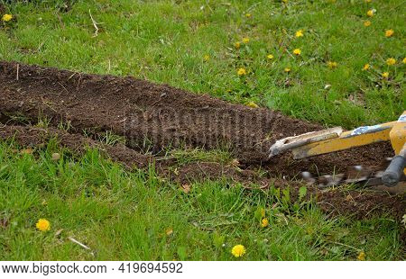 Excavation Work In The Garden Or Park. Installation Of Automatic Irrigation. Pipe Digging Manual Mac